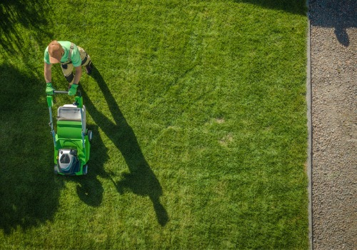 Overhead Shot of Maintenance Worker Preforming Lawn Mowing Services for East Peoria IL