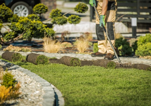 Shot of Man Laying Grass for Landscaping in East Peoria IL